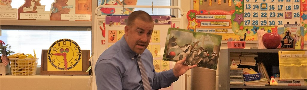 Mr. Hartmann reads to students